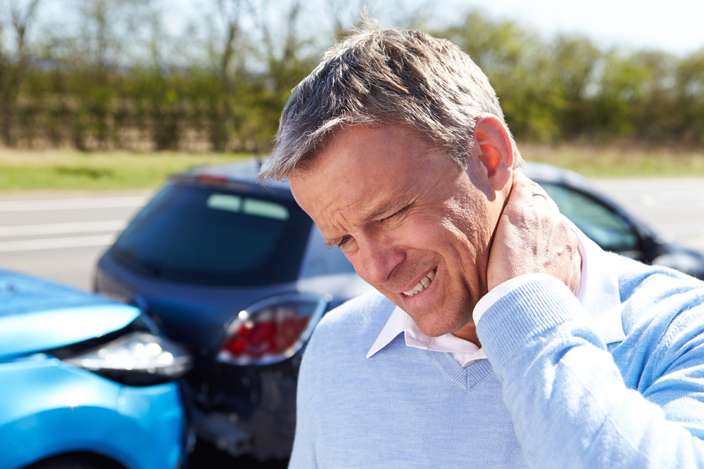 Man with whiplash needs chiropractic care in Dallas, TX.
